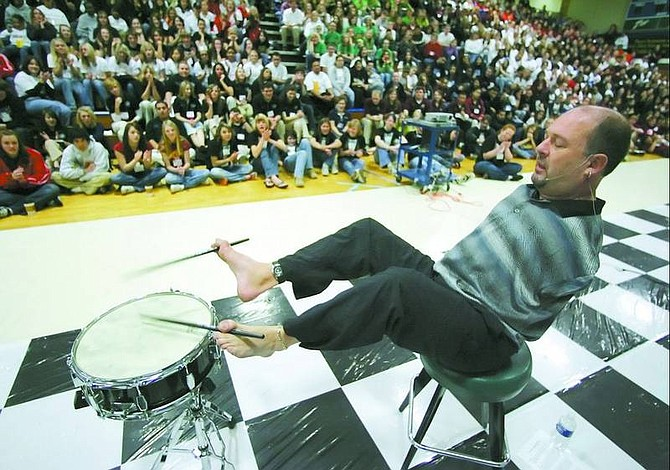 BRAD HORN/Nevada Appeal Motivational speaker Alvin Law plays a snare drum at Carson High School on Friday morning. Law, who has spoken to more than one million students, was born without arms, but doesn't let it get in the way of his dreams.