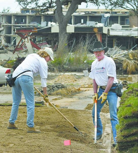 Photo Courtesy of Tourism Cares for Tomorrow Ed Spears, of White Pine County, and a woman work in D'Iberville, Miss., on a recent trip to help restore part of the storm-damaged areas from Hurricane Katrina.