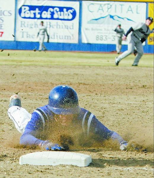 BRAD HORN/Nevada Appeal Carson's Sean Costella dives safely into third base after hitting a triple and driving in the go ahead run in the sixth inning in the Senator's game against Damonte Ranch at Ron McNutt Field on Saturday. Costella scored on the play on an error.