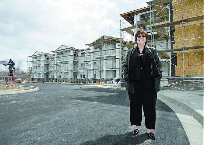 Chad Lundquist/Nevada Appeal Janice McIntosh, director of Carson City Senior Citizens Center, stands outside the Autumn Village affordable housing complex Wednesday.