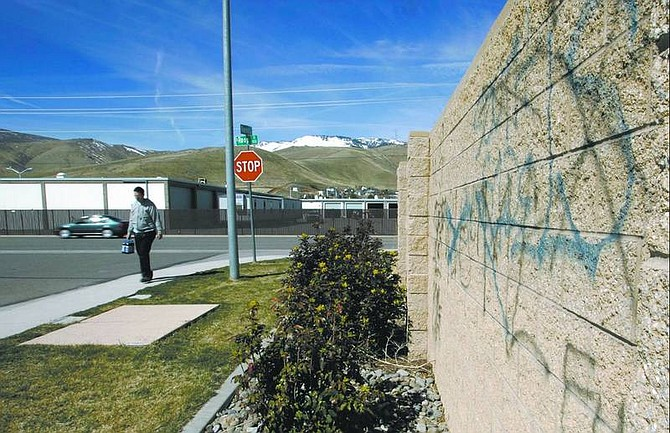 Cathleen Allison/Nevada Appeal Graffiti found on the walls around the post office at Roop Street and Little Lane has been there for three weeks. A gang officer said Carson City graffiti is a way for rival gangs to call each other out.