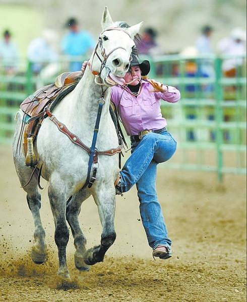 BRAD HORN/Nevada Appeal Casie Fowler competes in the goat tying competition at the Carson/Douglas High School Rodeo on Saturday.