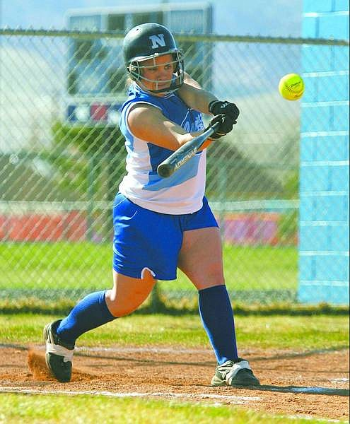 BRAD HORN/Nevada Appeal Dacey Hassey belts a double against the South Lake Tahoe Vikings during their game in Carson on Thursday.