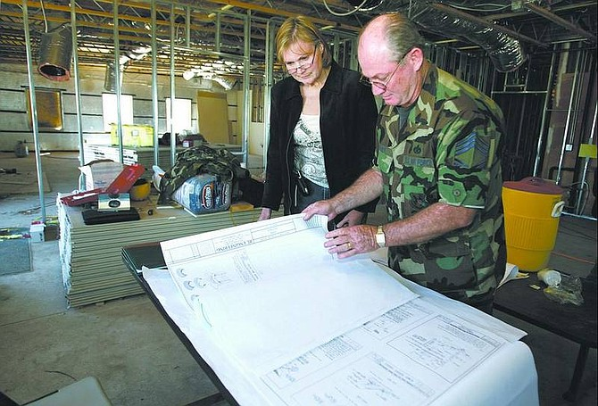 Cathleen Allison/Nevada Appeal Head Start Program Manager Sharon Doan talks with Air Force Chief Master Sgt. Kenneth Woody about the construction of a 5,100-square-foot school being built in South Carson City. The new building is expected to open in September.