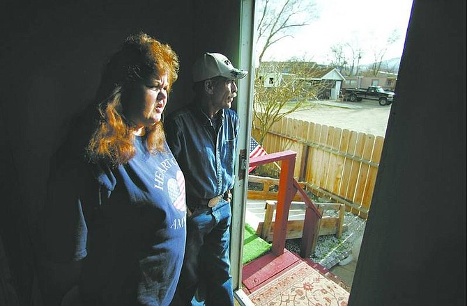 BRAD HORN/Nevada Appeal Debra Kinkel and her husband Chuck look out the front door of their home at the Mountain View Mobile Home Park in Carson City on Thursday. The Kinkels have lived at the park for six years and were getting ready to sell their home but the recent sale of the property has forced the couple to change their plans.
