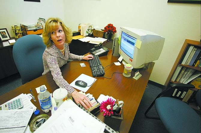 BRAD HORN/Nevada Appeal Brenda Fagg, branch manager at Westaff in Carson City, uses the Basic Pilot Program in her office Thursday. The program, offered by immigration services, determines if a person is authorized to work in the United States.