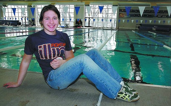 Kevin Clifford/Nevada Appeal Carson Senior Jamie Engan, 18, received a full-ride scholarship for her swimming talents to the University of Iowa.  At Carson Aquatic Center 6/13/06