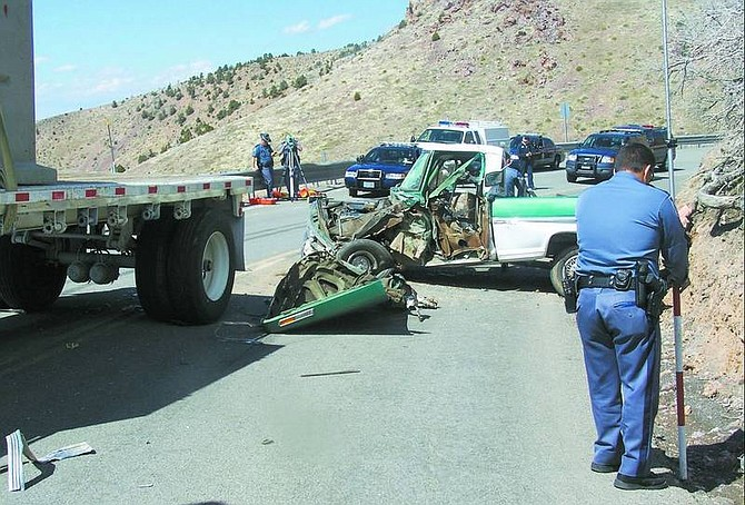 Photo courtesy Nevada Highway Patrol Nevada Highway Patrol troopers investigate a head-on collision between a truck and a semi Thursday afternoon on Geiger Grade near the lookout. Three people were taken to the hospital and the highway was closed for more than three hours. Alcohol and speed are believed to have contributed to the accident.