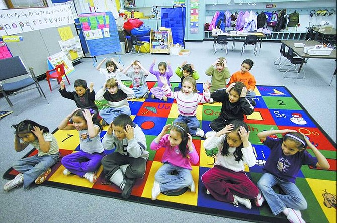 BRAD HORN/Nevada Appeal file photo Joanne Green's kindergarten class at Empire Elementary School learns the days of the week and months of the year in February. Empire's kindergarten class of 2006-'07 will be the first and only in Carson City to attend all day. Full-day kindergarten was put in place at Empire because of the school's large at-risk student population and is expected to improve student achievement.