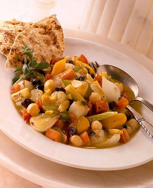 Moroccan Vegetable Ragout with Raisins is a full-flavored dish blends spicy and sweet and gets substance from potatoes and beans, among other vegetables, and the contrast of raisins. Serve it with grilled pita or other flat bread.   California Raisin  Marketing Board