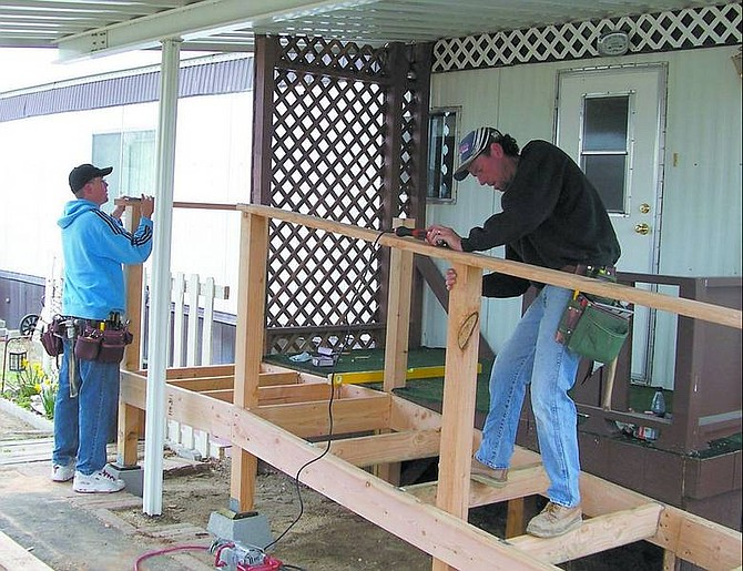 Brothers Mike Crandell, left, and John Crandell, members of the Southwest Regional Council of Carpenters, construct a wheelchair ramp recently in Carson City. The ramp will allow the homeowner to leave and enter her home more easily. Courtesy photo