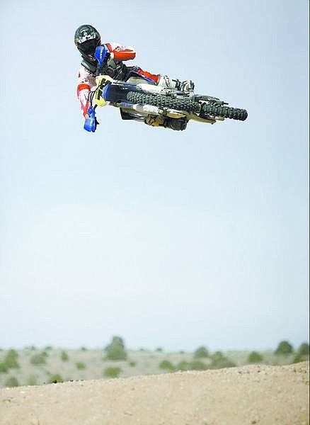 Cathleen Allison/Nevada Appeal Motocross rider Aron Harvey rides in North Carson City on Wednesday afternoon.