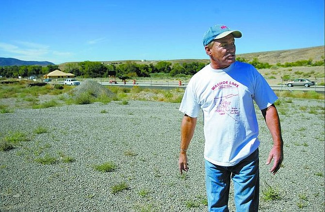 Mike Walker, owner of Dayton Valley Floral & Nursery, stands on an adjacent 8.7 acres off of Dayton Valley Road on Monday. Walker blames the Lyon planning department's conditions for costly delays of the 15 building commercial development. Chad Lundquist/ Nevada Appeal