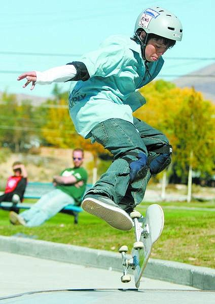 BRAD HORN/Nevada Appeal Andy Ferguson-McIntyre performs a trick during the Carson City Department of Parks and Recreation and the 702 Skate & Snowboard Shop's skateboard competition at Mills Park on Saturday.