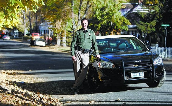 Chad Lundquist/Nevada Appeal Lt. Ken Sandage, of the Carson City Sheriff's Department, stands on Robinson Street - the epicenter of Carson City's trick-or-treating.