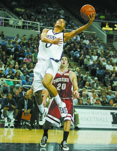 Nevada Wolf Pack guard Brandon Fields drives past Chico State guard Jon Baird during the first half of a college basketball game in Reno, Nev., on Tuesday, Nov. 7, 2006, at Lawlor Events Center. (AP Photo Brad Horn, Nevada Appeal)