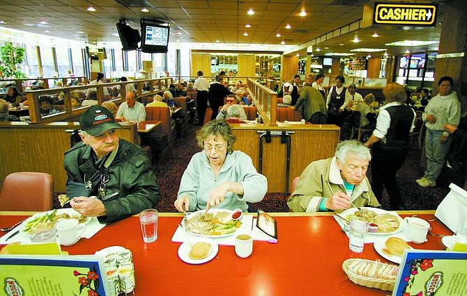 BRAD HORN/Nevada Appeal The counter and restaurant at the Nugget Coffeeshop filled quickly Thursday morning. The casino restaurant will serve between 3,200 and 3,500 free turkey or ham dinners for Thanksgiving and Christmas.