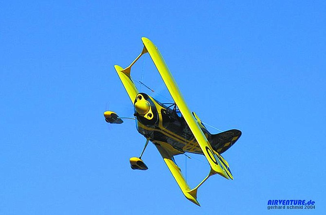 "photo courtesy of airventure.deSteve Brown's ""Tonopah Low,"" No. 00 biplane flies during the 2004 Reno Air Races."