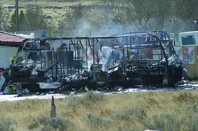 Marv Snow/Nevada Appeal News ServiceThis recreational vehicle pulled into Fifi's Mini Mart around 11 a.m. today and caught fire. By the time units from the Silver Springs Volunteer Fire Department arrived at the scene, the RV was fully engulfed.