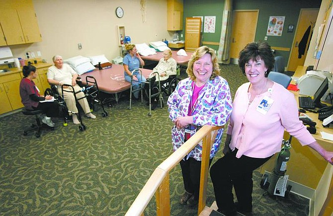 Cathleen Allison/Nevada Appeal Nurse Manager Char Foerschler and Debbie Christeson, outreach coordinator, pose in the gym area of the Rehabilitation Center at Carson Tahoe Regional Medical Center on Friday.