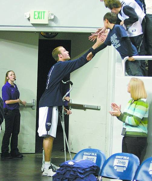 Nevada's Nick Fazekas shakes hands with fans after their college basketball game with Boise State in Reno, Nev., on Monday, Jan. 8, 2007. Fazekas injured his ankle in the first half. (AP Photo/Brad Horn)