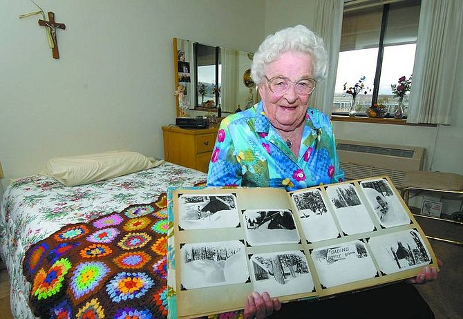 Kevin Clifford/Nevada Appeal Hilda McMurray, 93, shows photos Thursday afternoon from the massive 1951 snowstorm that blanketed the South Lake Tahoe area with more than 10 feet of snow. The storm isolated McMurray along with her husband, Don, and their children Margie and Norman for more than six weeks.