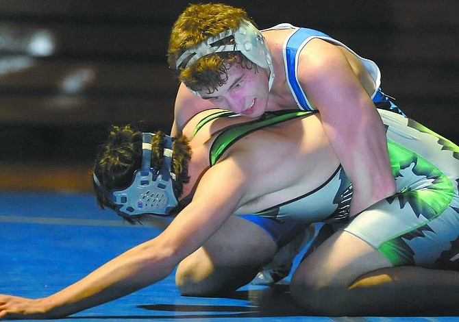 Kevin Clifford/Nevada Appeal Carson Senator Travis Lamborn tries to pin down Fallon Greenwave Ryan McCormick in a match Wednesday night.