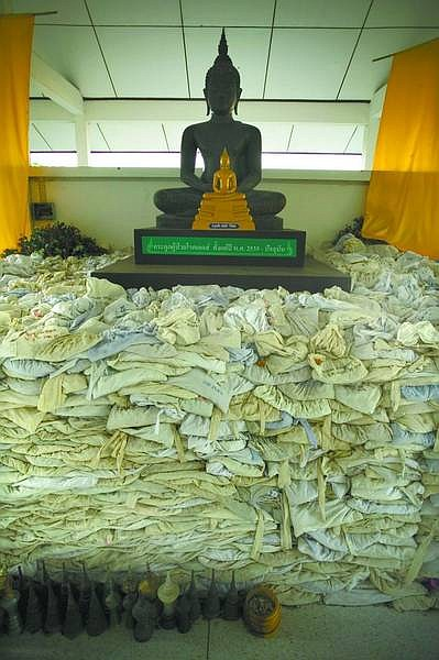 Pictured above are the cremated remains of the deceased at the Phrabatnampu Temple. After being cremated, the temple sends letters to the relatives to collect the remains. Most don't reply. If so the temple sends the remains via registered mail. More often than not, they come straight back to the temple.