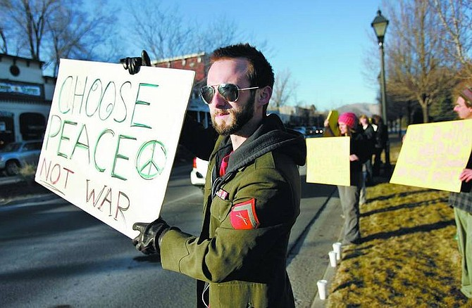Former Marine Clint Darquea, 23, protests the war in front of the Legislative Building on Monday, Jan 15. Darquea is one of the organizers of a series of peace marches at the Capitol. The next march is scheduled for 12:30 p.m. today.   Chad Lundquist/ Nevada Appeal