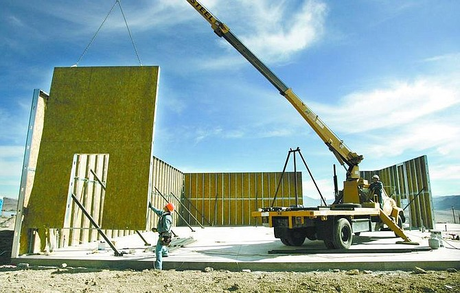Cathleen Allison/Nevada Appeal Workers from Scully Steel install wall panels Friday at the new Celtic Lawn & Landscaping building in Mound House.