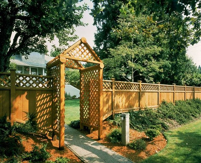 CedarOne/Associated Press Do-it-yourselfers should integrate new structures with features of the existing yard and home. Natural materials, such as cedar, weather to a pleasing, neutral gray and mesh well with most yardscapes.