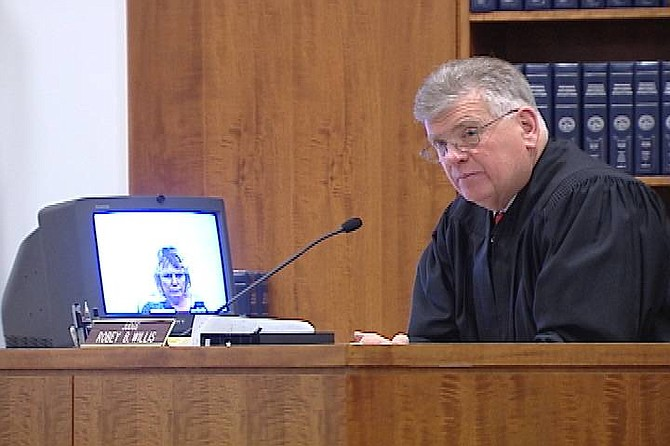 Photo courtesy of Sherrie curutti/Channel 2 KTVN Judge Robey Willis listens to testimony Friday during the arraignment of mark Daniel Fiddler.