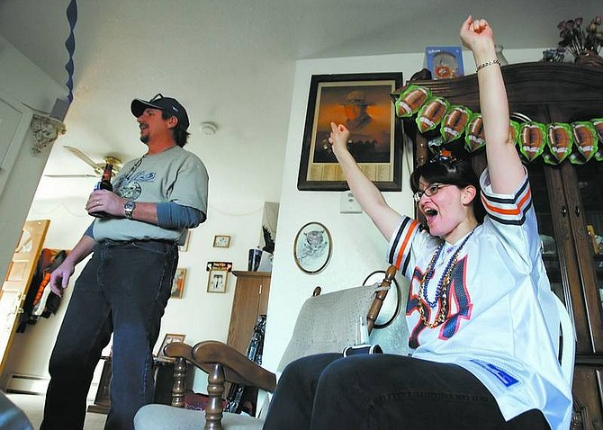 Chad Lundquist/Nevada Appeal Lisa Skelley, right, reacts to a Bears touchdown while her husband Dean, a Colts fan, stands quietly. With both of their teams in the Super Bowl, the couple threw a party so their friends and family could watch their feud as the game progressed.