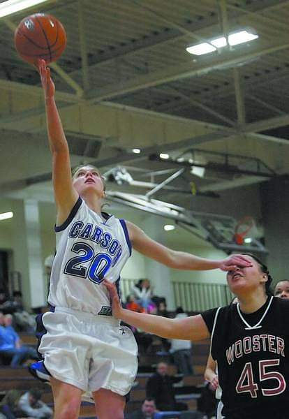 Chad Lundquist/Nevada Appeal Carson's Sarah Evans blocks Reno's Barbara Castellanos during Tuesday's game.