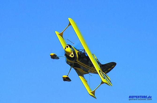 "Steve Brown's ""Tonopah Low,"" No. 00 biplane flies during the 2004 Reno Air Races.  photo courtesy of airventure.de"