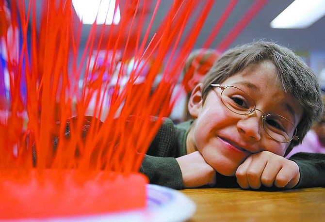 Chad Lundquist/Nevada Appeal Sutro Elementary School first-grade, Austin Mitchell, 7, celebrates the 100th day of school by building a spaghetti sculpture with 100 noodles as well as dressing up as a 100-year-old man.