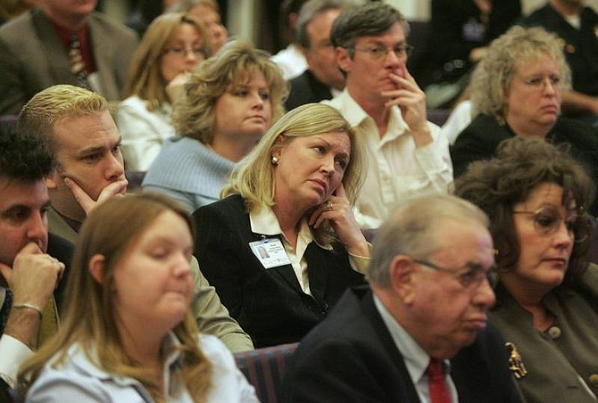 BRAD HORN/Nevada Appeal Tricia Larmer, of West Hills Hospital in Reno, center, listens during a methamphetamine presentation before the Assembly Health and Human Services Committee and the Senate Human Resources and Education Committee at the Nevada State Legislature on Wednesday.