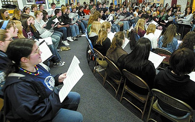 Carson High School senior Kiona Roath, left,  sings with the honor choir at Douglas High School during rehearsal Wednesday for tonight's performance of the Honor Choir at Douglas High.   Shannon Litz/ Nevada Appeal News Service