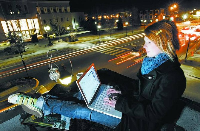 Photo Illustration by Chad Lundquist/Nevada Appeal Jessica Rao, 18, of Gardnerville, chats with a friend in New York through Comma Coffee's wireless internet connection on Monday night. Comma Coffee and the Legislature building are just a couple of the hotspots popping up around town.