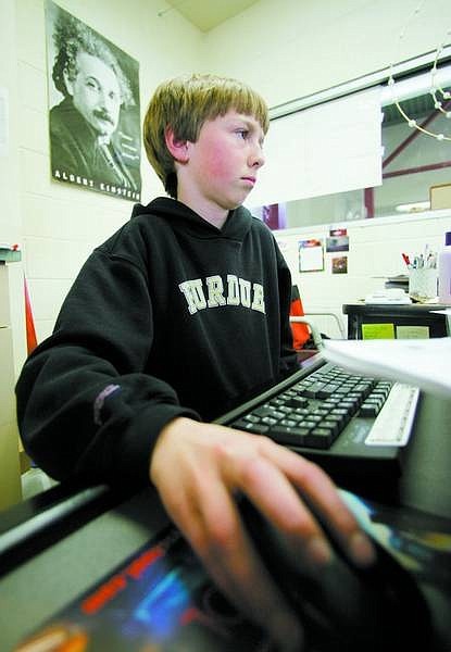 BRAD HORN/Nevada Appeal Lucas Johnson, 13, studies astronomy in Mary Stanley's science classroom at Carson Middle School on Thursday. Stanley's students are competing at the Science Olympiad in Las Vegas on Saturday.