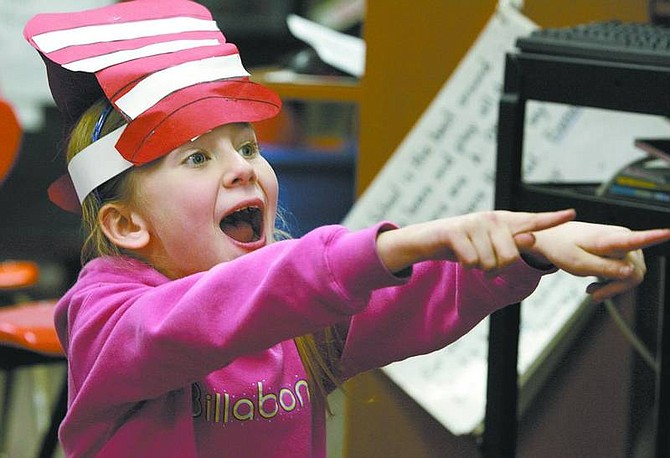Cathleen Allison/Nevada Appeal Calli Hess, 6, reacts during a Dr. Seuss game with her first-grade class at Fremont Elementary School on Friday afternoon. Area students participated in Read Across America Day activities.