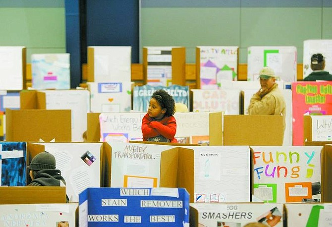 BRAD HORN/Nevada Appeal Shalie Kenney, 5, of Dayton, sits on her father, Charles', shoulders at the Dayton Intermediate School's science fair.
