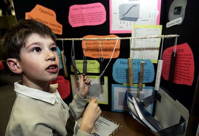Chad Lundquist/Nevada Appeal Fred Christensen, 9, a fourth-grader from Seeliger Elementary shows his project that determines the musical key of different materials at Western Nevada Community College on Tuesday night during the Carson City School District Science Fairs Awards Night.