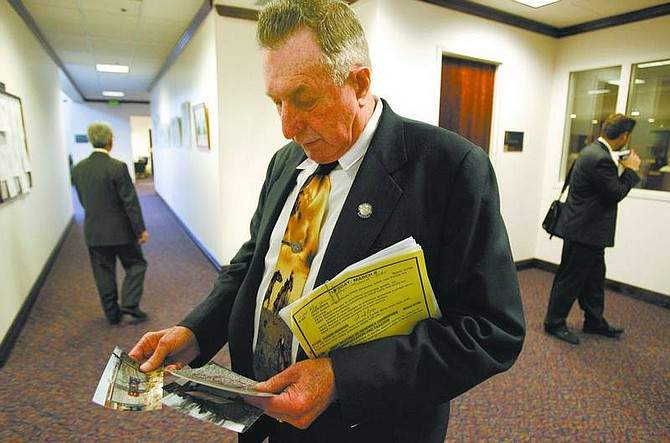 Cathleen Allison/Nevada Appeal Nevada Assemblyman John Carpenter, R-Elko, prepares to talk Tuesday morning, at the Legislature in Carson City about the ongoing graffiti problems at a park near his rural Nevada home. Carpenter was pushing for tougher penalties in a bill that would mandate lengthy community service sentences and loss of driving privileges for those convicted of vandalizing property with graffiti.