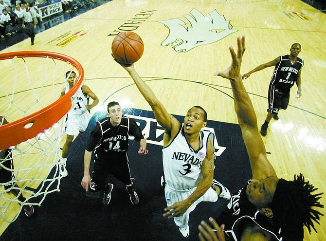 BRAD HORN/Nevada Appeal Nevada senior guard Kyle Shiloh drives to the basket during the first half at Lawlor Events Center during the Wolf Pack's game against New Mexico State.