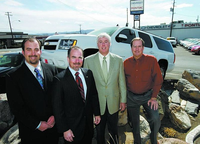 Chad Lundquist/Nevada Appeal Michael Hohl, president and owner of The Michael Hohl Automotive Group, signed a dealer agreement with General Motors on Wednesday afternoon. Left to right, Michael Hohl Jr.; Bob Hilgardner, western region zone manager for GM; Michael Hohl; and Ken Jochim, controller for Michael Hohl Automotive.