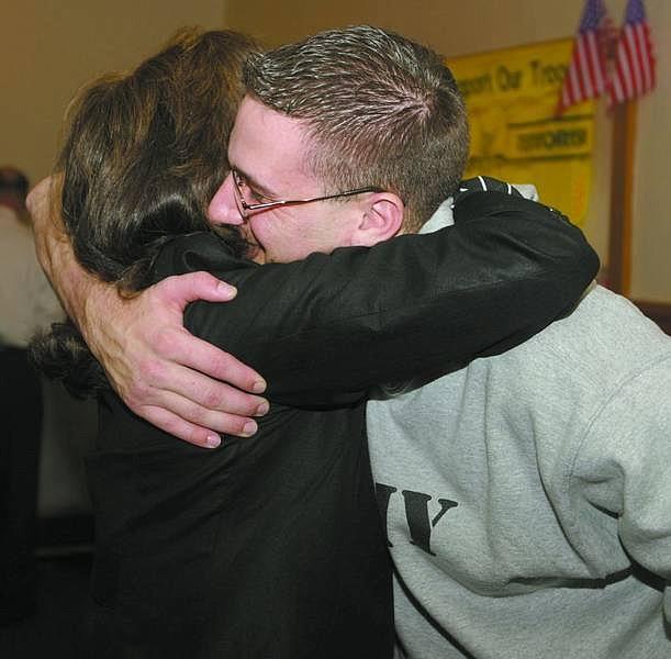 Niki Newbold/Appeal News Service Pfc. Daniel Tingle's former first-grade teacher, Lynne Egan, hugs him at Sharkey's Casino in Gardnerville.