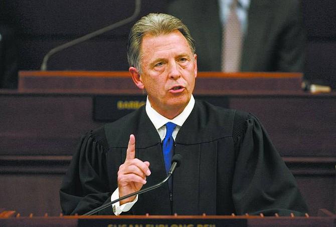 Cathleen Allison/Associate Press Nevada Supreme Court Chief Justice Bill Maupin addresses the Legislature on Wednesday night at the Legislature in Carson City.