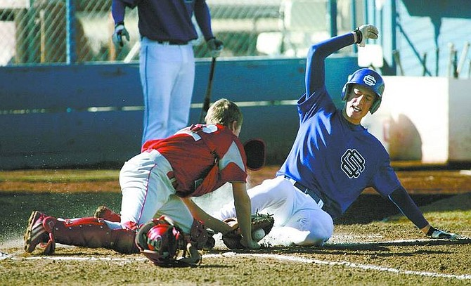 Cathleen Allison/Nevada AppealCarson's Tony Fagan slides safely under the tag of Truckee's Kevin Decker during Thursday's game at CHS.