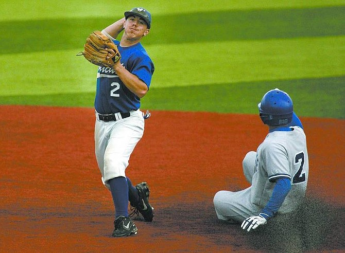 Cathleen Allison/Nevada Appeal Wildcat's Kyle Bondurant turns a double play against Joshua Chevalier of Salt Lake Community College during Friday's game at WNCC.